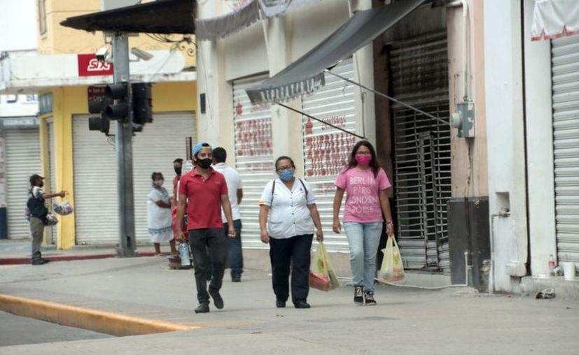 El uso correcto del cubrebocas es una barrera para el virus. (Novedades Yucatán)