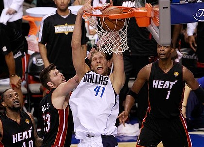 Dirk Nowitzki of the Dallas Mavericks towers above the Heat defence.