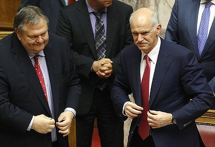 Greece's PM George Papandreou (R) and Finance minister Evangelos Venizelos smile after winning a vote of confidence.