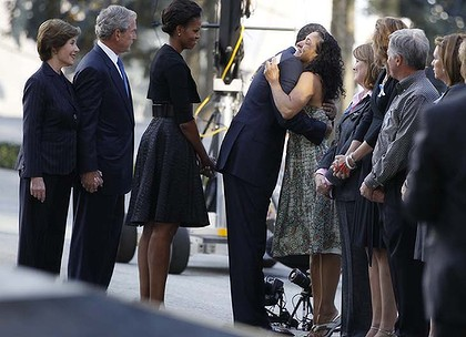 Ten years on ... President Barack Obama embraces a victim's relative as he visits the north pool of the World Trade Center site with first lady Michelle Obama, former President George W. Bush and former first lady Laura Bush.