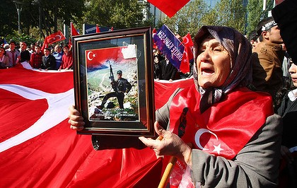 Yeter Eroglu holds a photograph of her son, Murat Eroglu, 22, a Turkish soldier killed by Kurdish rebels, as she joins thousands of high school students and citizens marching in the streets of the Turkish capital, Ankara,  on October 20, 2011. Mourning Turkey paid its last respects to 24 soldiers killed by Kurdish rebels on the Iraq border as the Turkish air force pounded rebel camps in northern Iraq.