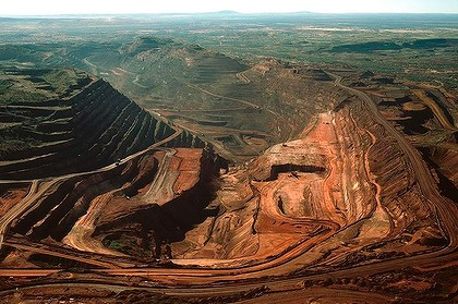 The biggest single-pit open-cut iron ore mine in the world, the BHP Biliton Mount Whaleback mine, 455 km (283 miles) south of Port Hedland is seen in this undated handout photograph obtained August 12, 2009. BHP Billiton Ltd, the world's largest miner, reported a 30 percent slide in annual profit excluding writedowns, its first fall in seven years, pummelled by a slump in metals prices and demand.