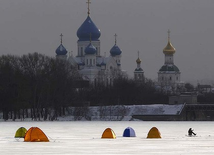 Fisherman's tents on the Moscow River in Moscow, Russia. The death toll from a severe cold spell in Eastern Europe has risen to 79.