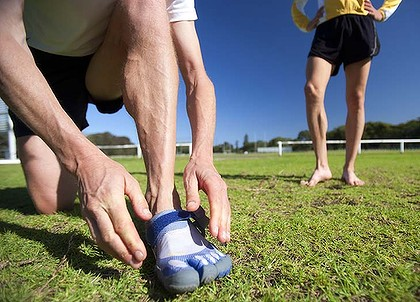 "Barefoot running enthusiasts are adopting ""foot-gloves"" while some go without shoes altogether."