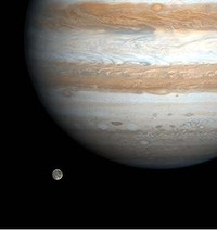 The solar system's largest moon, Ganymede, is captured here alongside the planet Jupiter in this picture taken by NASA's Cassini spacecraft, December 3, 2000. Ganymede is larger than the planets Mercury and Pluto and Saturn's largest moon, Titan. Both Ganymede and Titan have greater surface area than the entire Eurasian continent on our planet. Cassini was 26.5 million kilometers (16.5 million miles) from Ganymede when this image was taken. The smallest visible features are about 160 kilometers (about 100 miles) across.
