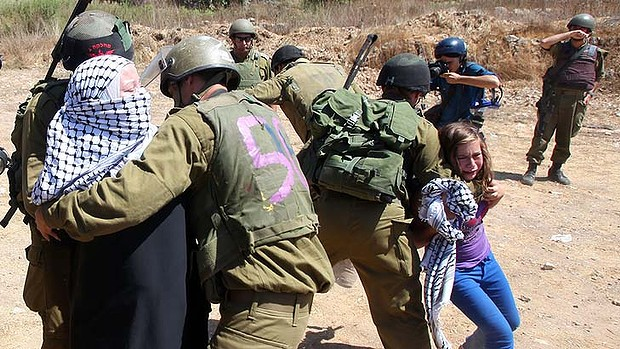 A Palestinian girl cries as Israeli soldiers arrest her mother during a protest over land confiscation in al-Nabi Saleh.
