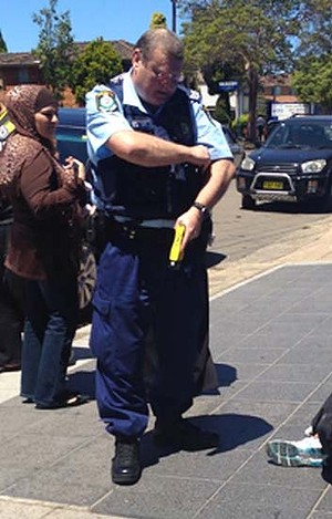 The policeman blamed for starting the trouble in Punchbowl with what looks like a taser in his hand.