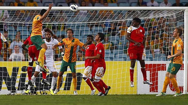 Fightback: Tim Cahill scores Australia's first.