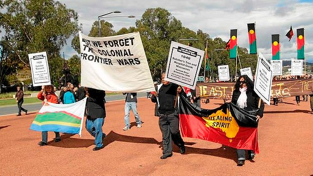 Aboriginal community during the march at the Anzac Day 2012.