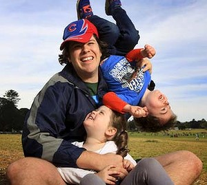 Cameron McKay with his twin children (aged 3) Thomas and Madison (and William) at Centennial Park where he often takes them to get out of the house.