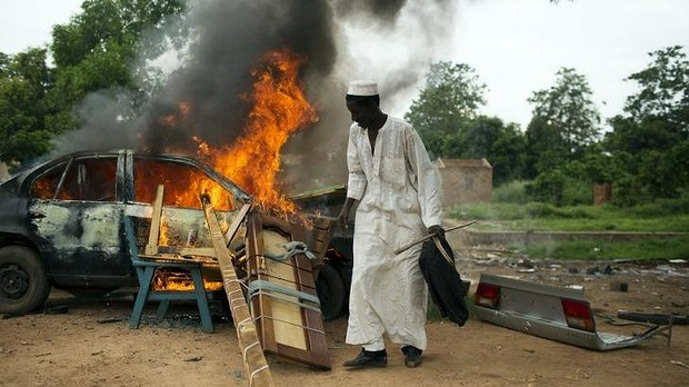 Some departing Muslims set their cars on fire as they could not take them in the convoy but did not want Christians to be able to use them.
