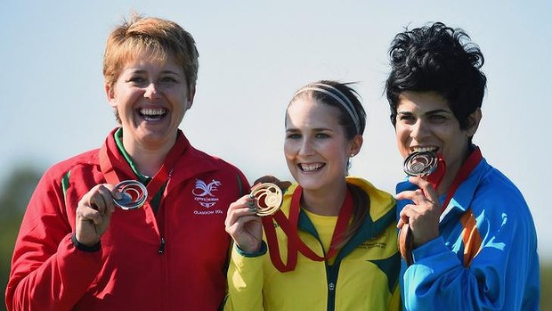 On the podium ... from left, Elena Allen of Wales, Laura Coles of Australia and Andri Eleftheriou of Cyprus receive their medals after winning the Women's Skeet final at Barry Buddon Shooting Centre.