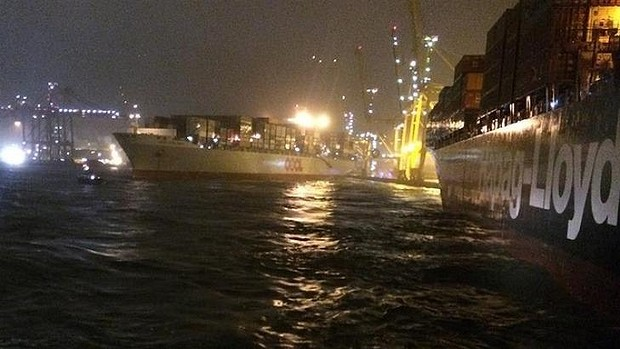 OOCL Hong Kong swings out after moorings cut by Kiel Express - puncturing its stern on the wharf.