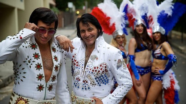 Bright light city: Elvis impersonators Paul Fenech and Ross Mancini, with show girls, dust off their outfits ahead of the Elvis Festival in Parkes.