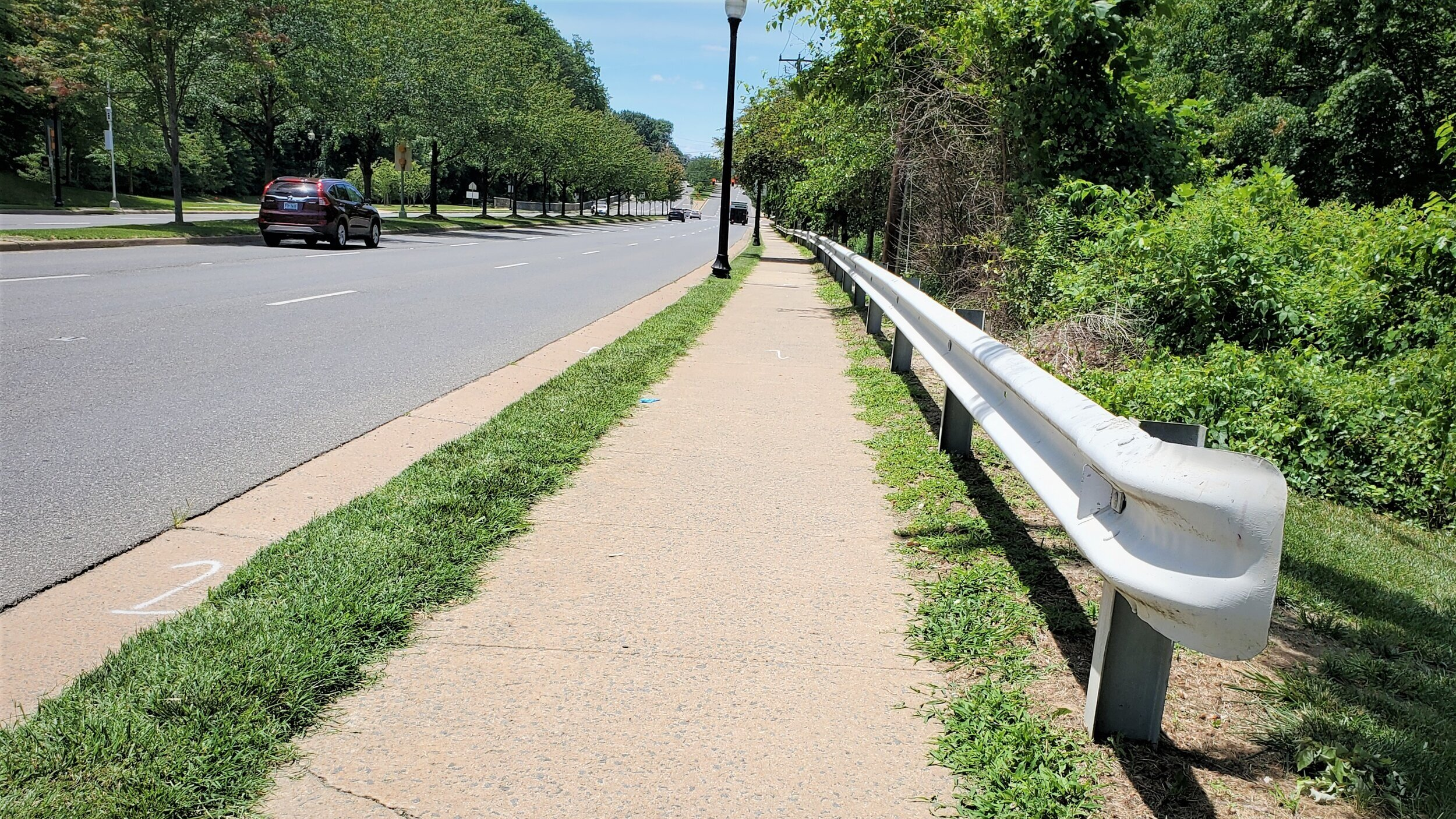 The guardrail's placement is technically correct, but it symbolizes the protection accorded to motorists and denied to other users of the road.