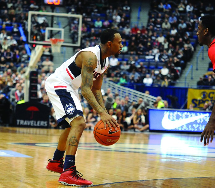 UConn senior guard Ryan Boatright dribbles the ball against Southern Methodist at XL Center in Hartford on March 1, 2015. Boatright is one of three UConn seniors the team will honor at tonight's Senior Night ceremony at Gampel Pavilion. (Jon Kulakofsky/The Daily Campus)