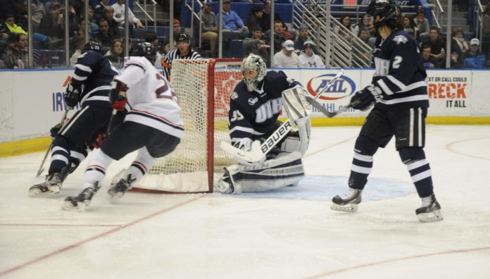 The UConn men's hockey team skates in a game against New Hampshire on Feb. 21, 2015. The Huskies fell to the Wildcats 5-2 last night in the first leg of the 2015 Hockey East playoffs. (Photo by Stephen Quick/The Daily Campus)