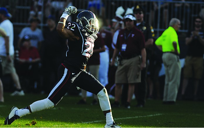 UConn safety Andrew Adams celebrates after making a tackle during the Huskies' game against Temple at Rentschler Field in East Hartford, Connecticut on Sept. 27, 2014. Adams led the team with four interceptions last season. (Troy Caldeira/The Daily Campus)