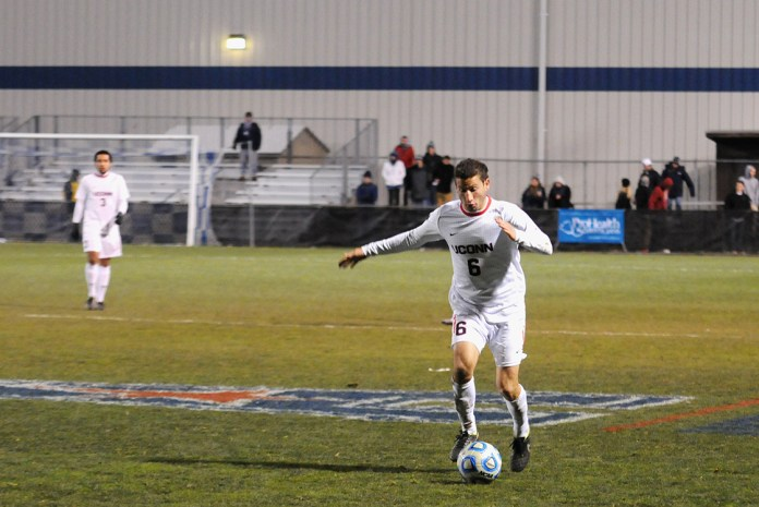 UConn defender Benjamin Wagman dribbles up the field against South Florida during the American Athletic Conference tournament at Joseph J. Morrone Stadium on Nov. 14, 2014.(Amar Batra/The Daily Campus)