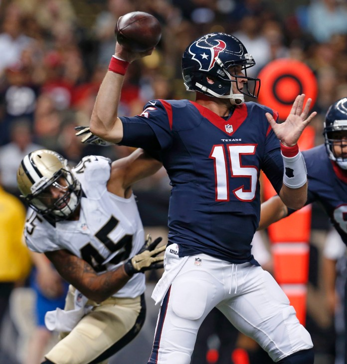 Houston Texans quarterback Ryan Mallett (15) passes under pressure from New Orleans Saints outside linebacker Hau'oli Kikaha (45) in the first half of a preseason game in New Orleans, Sunday, Aug. 30, 2015. (Jonathan Bachman/AP)