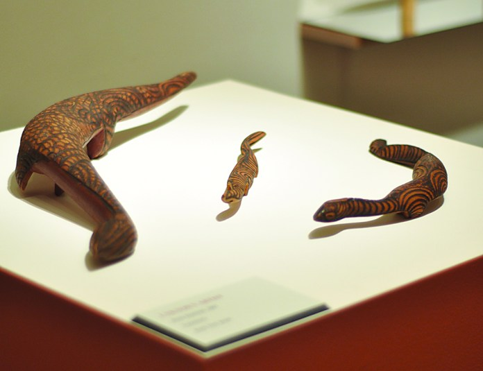 """Wood carvings included in the """"Dotted Dialogues"""" exhibit at The Benton. (Santiago Pelaez/The Daily Campus)"""
