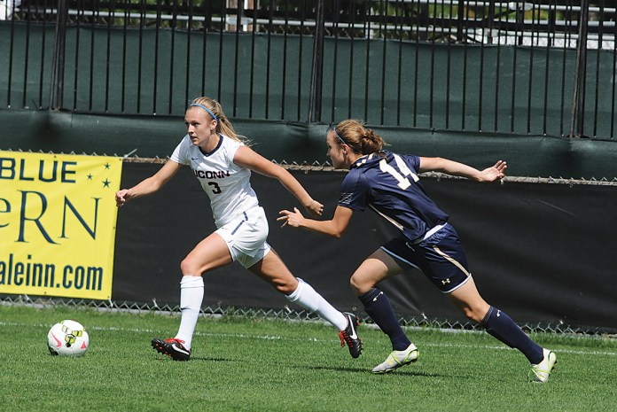 In this file photo, UConn junior forward Rachel Hill dribbles past a Navy player during a women's soccer game at Joseph J. Morrone Stadium in Storrs, Connecticut on Aug. 24, 2014. (File Photo/The Daily Campus)
