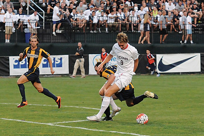 UConn freshman forward Fredrik Jonsson tries to win the ball off a Quinnipiac defender during the Huskies' game against the Bobcats on Aug. 31, 2015. The team will be looking to Jonsson to provide a scoring spark this season. (Amar Batra/The Daily Campus)