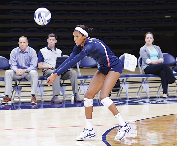 UConn junior outside hitter Jade Strawberry returns the ball during the Dog Pound Challenge last weekend. Strawberry led the way for UConn in game one against Bryant University, recording a double-double consisting of a career-high 15 kills and 14 digs. (Jason Jiang/The Daily Campus)
