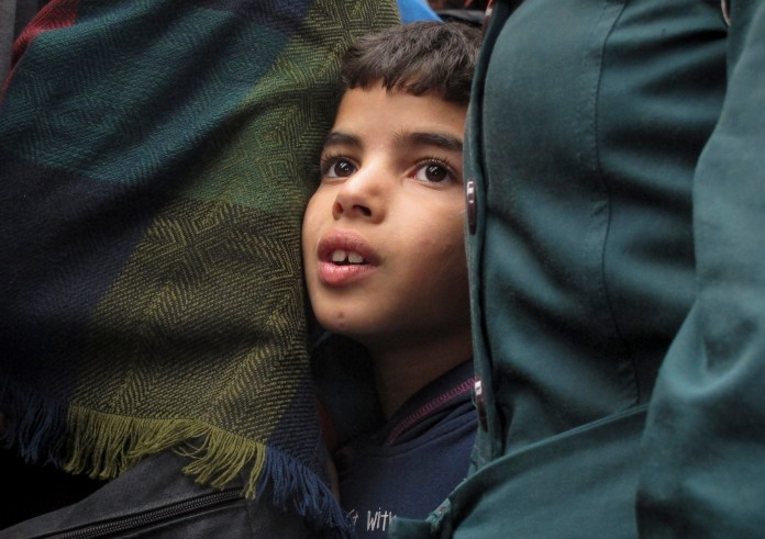 Laith Egbari, 7 years old from Aleppo, Syria, waits in line to board a train at Keleti train station in Budapest, Hungary, Thursday, Sept. 10, 2015. (Shawn Pogatchnik/AP)