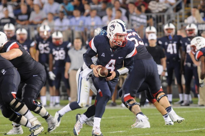 UConn quarterback Bryant Shirreffs drops back during the Huskies' game against Villanova on Thursday, Sept. 3, 2015. The Huskies defeated the Wildcats to kick off the 2015-16 season. (Ashley Maher/The Daily Campus)