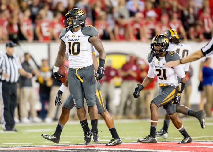 Missouri linebacker Kentrell Brothers (10) celebrates with the defense after he intercepted an Arkansas State pass during the second half of an NCAA college football game, Saturday, Sept. 12, 2015, in Jonesboro, Arkansas.(Gareth Patterson/AP)