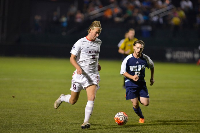 UConn men's soccer freshman forward Fredrik Jonsson dribbles downfield during the Huskies' game against Rhode Island at Joseph J. Morrone Stadium in Storrs, Connecticut on Saturday, Sept. 19, 2015. Jonsson scored the team's lone goal, the first of his UConn career. (Jason Jiang/The Daily Campus)