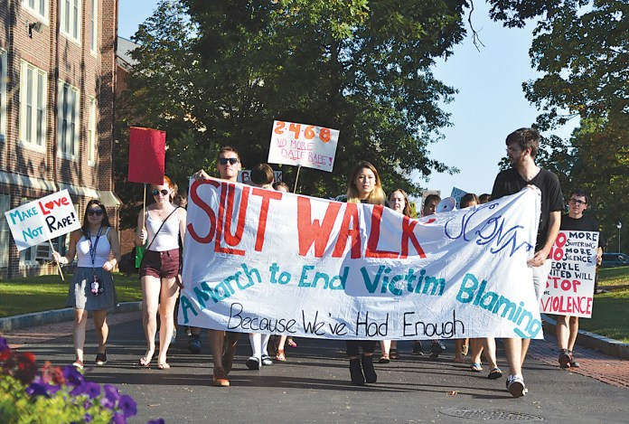 Members of the UConn Revolution Against Rape SlutWalk march down Mansfield Way in Storrs, Connecticut on Friday, Sept. 18, 2015. (Amar Batra/The Daily Campus)
