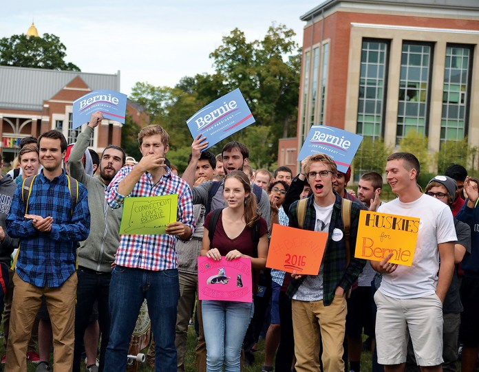 Attendees of the Students for Bernie Sanders rally stand on the Student Union Mall on Sept. 22, 2015. The student-led political rally attracted nearly 250 people. (Amar Batra/The Daily Campus)