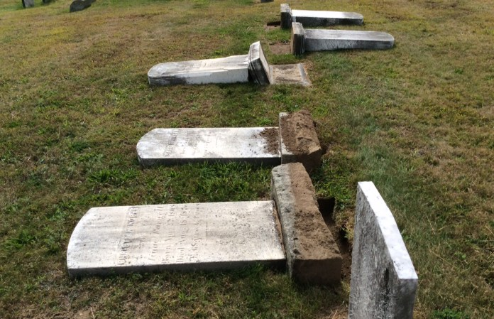 In this photo, vandalized gravestones are pictured in the Storrs Cemetary in Storrs, Connecticut.The cemetery, located on the north end of campus, is 150 years old and contains gravestones dating back to the 1800s. (Courtesy/Rene Lizee)