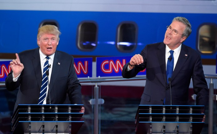 Republican presidential candidates, former Florida Gov. Jeb Bush, right, and Donald Trump both speak during the CNN Republican presidential debate at the Ronald Reagan Presidential Library and Museum on Wednesday, Sept. 16, 2015, in Simi Valley, Calif. (Mark J. Terrill/AP)