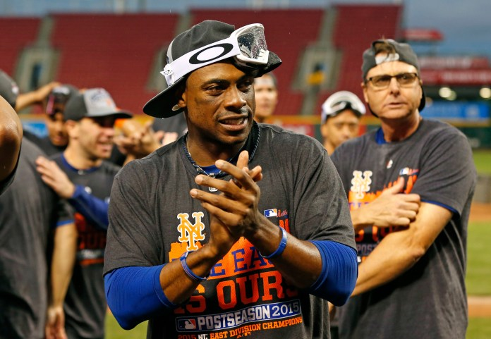 New York Mets Curtis Granderson celebrates on the field after clinching the NL East title following their 10-2 win over the Cincinnati Reds, Saturday, Sept. 26, 2015, in Cincinnati. (Aaron Doster/AP)