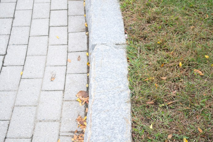 In this photo, a granite curb is seen on the UConn campus.The university's granite curbs were installed between 1995 and 1996 as part of the UConn 2000 plan under President Harry J. Hartley. (Rebecca Newman/The Daily Campus)