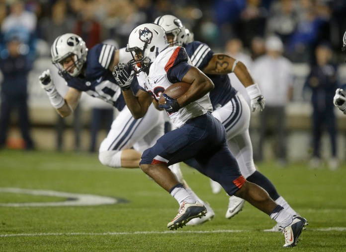 Connecticut running back Arkeel Newsome (22) carries the ball in the first half during an NCAA college football game against BYU Friday, Oct. 2, 2015, in Provo, Utah. (Rick Bowmer/AP)