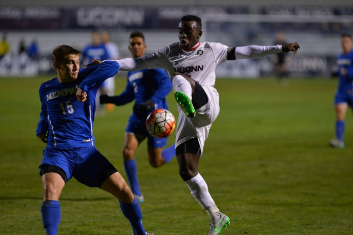 UConn junior midfielder Kwame Awuah brings the ball down during the Huskies' game against Memphis at Joseph J. Morrone Stadium in Storrs, Connecticut on Saturday, Oct. 3, 2015. (Jason Jiang/The Daily Campus)