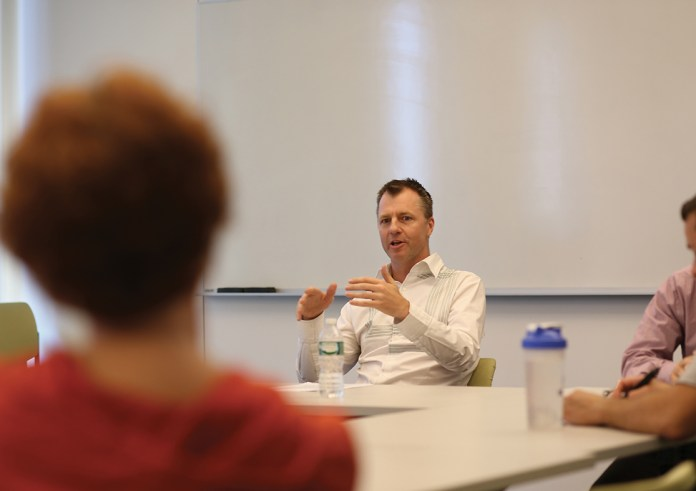 """Brendon O'Connor, associate professor of American Politics at the University of Sydney in Australia, speaks during his lecture """"The Ideology of American Exceptionalism"""" on Wednesday, Oct. 7, 2015. (Jackson Haigis/The Daily Campus)"""