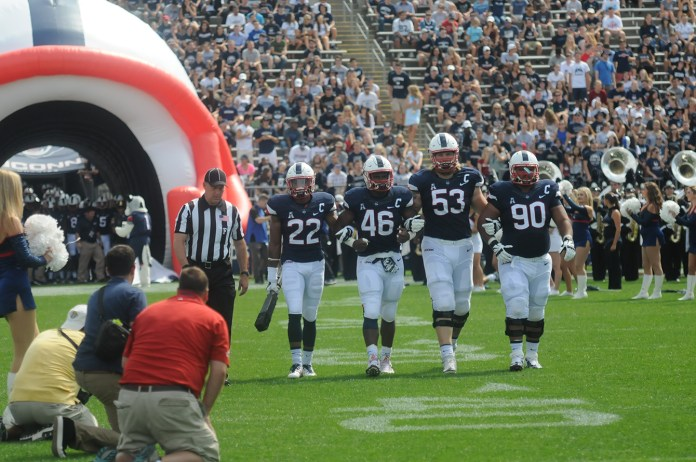 UConn's captains lead the team out of the tunnel prior to kicking off their game against Army at Pratt & Whitney Stadium at Rentschler Field in East Hartford, Connecticut on Saturday, Sept. 12, 2015. (Bailey Wright/The Daily Campus)
