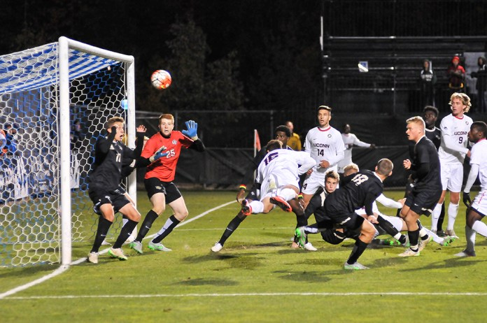 UConn junior captain Jake Nerwinski is seen scoring his game-winning goal in the 80th minute of the Huskies' game against UCF at Joseph J. Morrone Stadium in Storrs, Connecticut on Saturday, Oct. 17, 2015. (Jason Jiang/The Daily Campus)