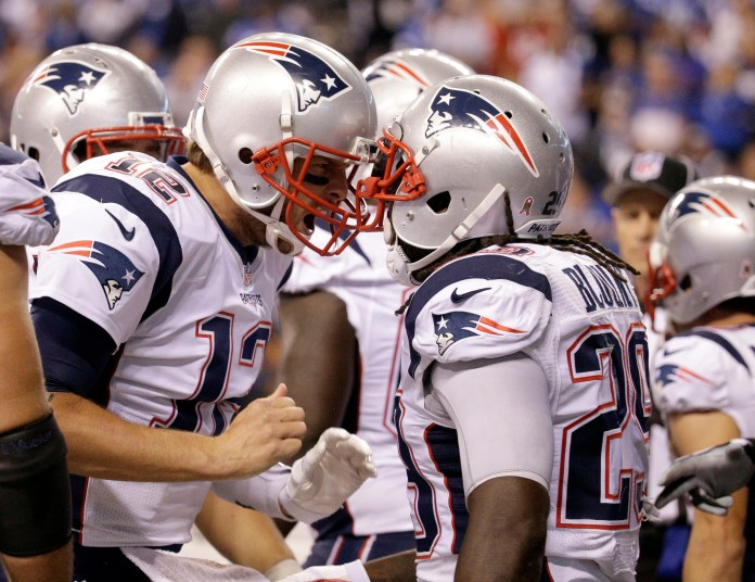 New England Patriots running back LeGarrette Blount (29) celebrates a touchdown with quarterback Tom Brady (12) in the second half of an NFL football game against the Indianapolis Colts in Indianapolis, Sunday, Oct. 18, 2015. (John Minchillo/AP)
