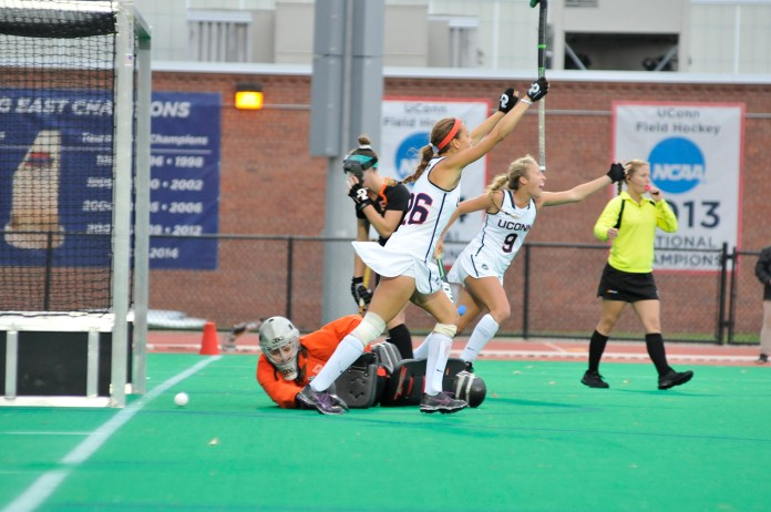 Charlotte Veitner (26) and Amelia Iacobucci (9) celebrate a goal during UConn's 4-1 victory over Princeton on Sunday, Oct. 25, 2015. The Huskies improved to 17-0 on the season with the victory. (Jason Jiang/The Daily Campus)