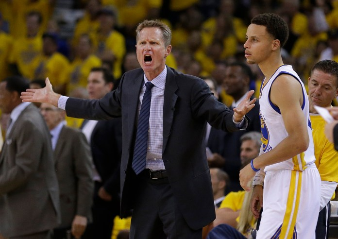 In this file photo from Tuesday, May 5, 2015, Golden State Warriors head coach Steve Kerr, left, reacts next to guard Stephen Curry during the first half of Game 2 in a second-round NBA playoff basketball series against the Memphis Grizzlies in Oakland, Calif. (Ben Margot/AP)
