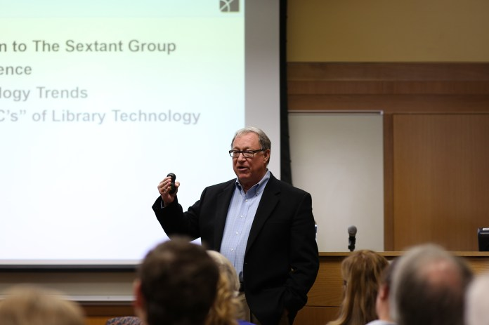 In this photo,Mark S. Valenti,president and CEO of technology consulting firm The Sextant Group, speaks at the Homer Babbidge Library's Class of 1947 meeting room on Tuesday, Oct. 27, 2015. (Jackson Haigis/The Daily Campus)