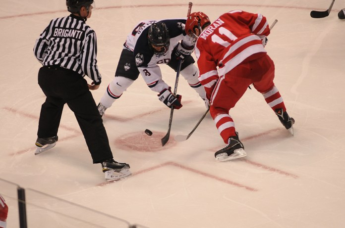 In this file photo, freshman forward Max Kalter takes a faceoff during the Huskies' game against Boston University at XL Center in Hartford, Connecticut on Tuesday, Oct. 27, 2015. (Amar Batra/The Daily Campus)