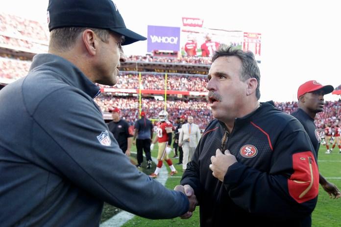 Baltimore Ravens head coach John Harbaugh, left, shakes hands with San Francisco 49ers head coach Jim Tomsula after an NFL football game in Santa Clara, Calif., Sunday, Oct. 18, 2015. The 49ers won 25-20. (Ben Margot/AP)