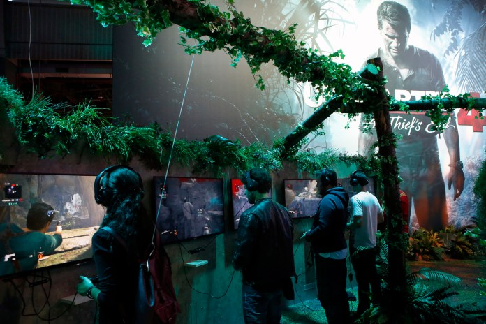Visitors play with the Playstation at the Paris Games Week, a trade fair for video games in Paris, France. (AP)